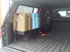 Jerry cans and spare tire frame.